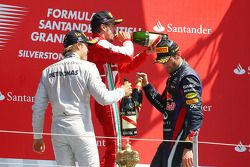Race winner Nico Rosberg Mercedes AMG F1 celebrates on the podium with second placed Mark Webber Red
