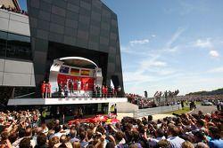 The podium Mark Webber Red Bull Racing, second; Nico Rosberg Mercedes AMG F1, race winner; Fernando