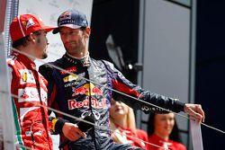 Fernando Alonso Ferrari talks with Mark Webber Red Bull Racing on the podium