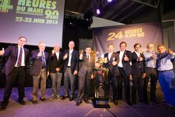 Group shot with Don Panoz, Gérard Larousse, Jim France, ACO President François Fillon, Tom Kristensen, Frank Biela, Emanuele Pirro, Henri Pescarolo and Jacky Ickx