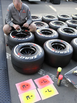 Pirelli tyres prepared by a McLaren mechanic