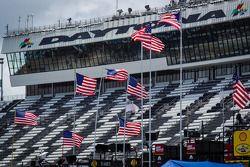 American flags wave over Daytona International Speedway garage area