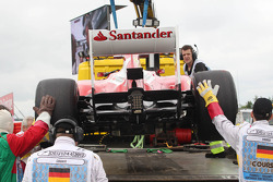 The Ferrari F138 of Fernando Alonso, Ferrari is recovered back to the pits on the back of a truck af