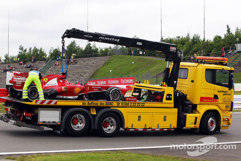 The Ferrari F138 of Fernando Alonso, Ferrari is recovered back to the pits on the back of a truck after he stopped in the first practice session