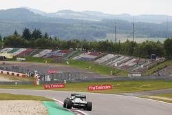 Mark Webber, Red Bull Racing RB9 leads Nico Rosberg, Mercedes AMG F1 W04