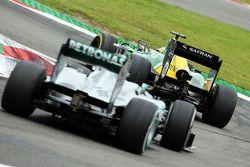 Charles Pic, Caterham CT03 leads Lewis Hamilton, Mercedes AMG F1 W04