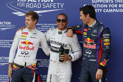 The top three qualifiers in Parc Ferme: Sebastian Vettel, Red Bull Racing, second; Lewis Hamilton, M