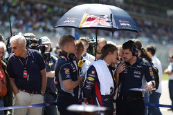Sebastian Vettel, Red Bull Racing with Guillaume Rocquelin, Red Bull Racing Race Engineer on the gri