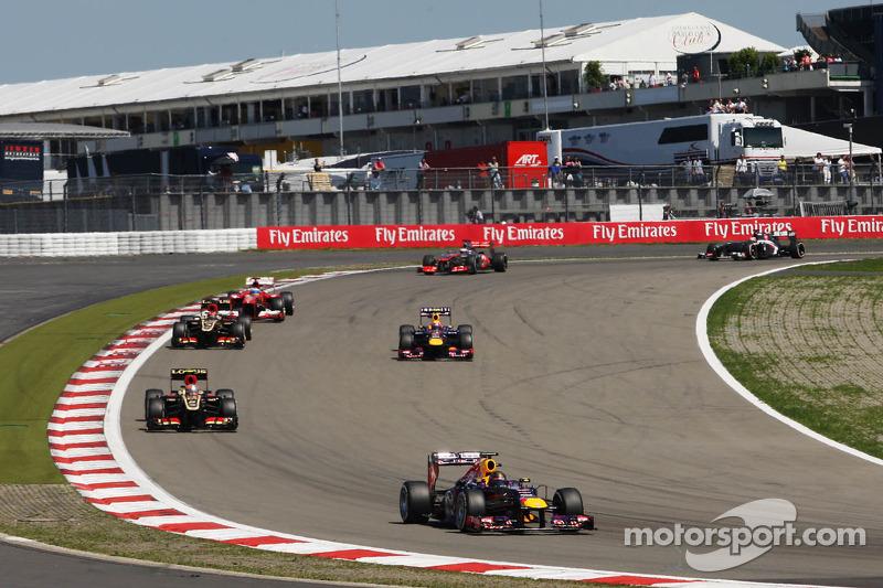 Sebastian Vettel, Red Bull Racing RB9 leads as Mark Webber, Red Bull Racing RB9 passes the field und