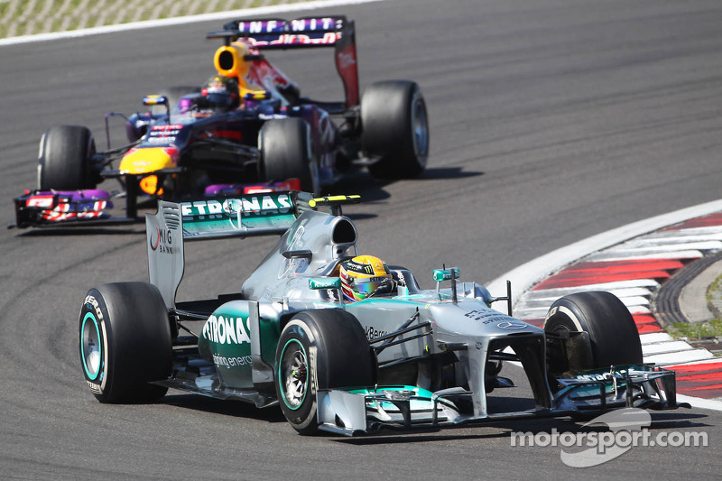 Lewis Hamilton, Mercedes AMG F1 W04 leads Sebastian Vettel, Red Bull Racing RB9