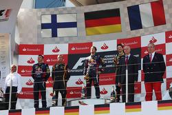 The podium, Kimi Raikkonen, Lotus F1 Team, second; Sebastian Vettel, Red Bull Racing, race winner; Romain Grosjean, Lotus F1 Team, third.
