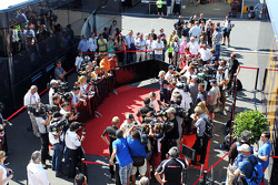 Kimi Raikkonen, Lotus F1 Team, Romain Grosjean, Lotus F1 Team, and Sebastian Vettel, Red Bull Racing with the media