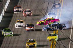 David Stremme, Swan Racing Toyota gets loose while A.J. Allmendinger, Phoenix Racing Chevrolet and Aric Almirola, Richard Petty Motorsports Ford crash