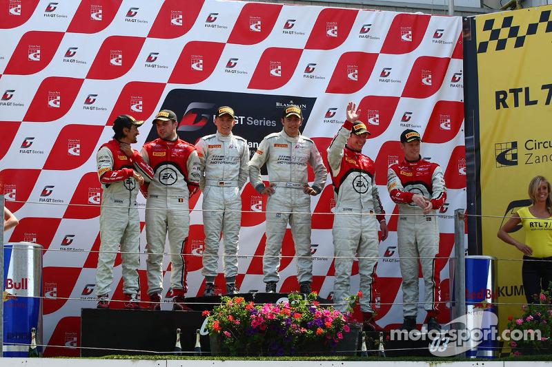 The podium: winners Maximilian Buhk, Alon Day, second place Stéphane Ortelli, Laurens Vanthoor, third place Frank Stippler, Edward Sandström
