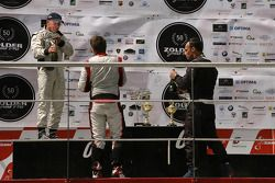 From left to right: champagne celebration for Peter Milavec, 2nd; Gary Hauser, 1st; Marc Faggionato, 3rd