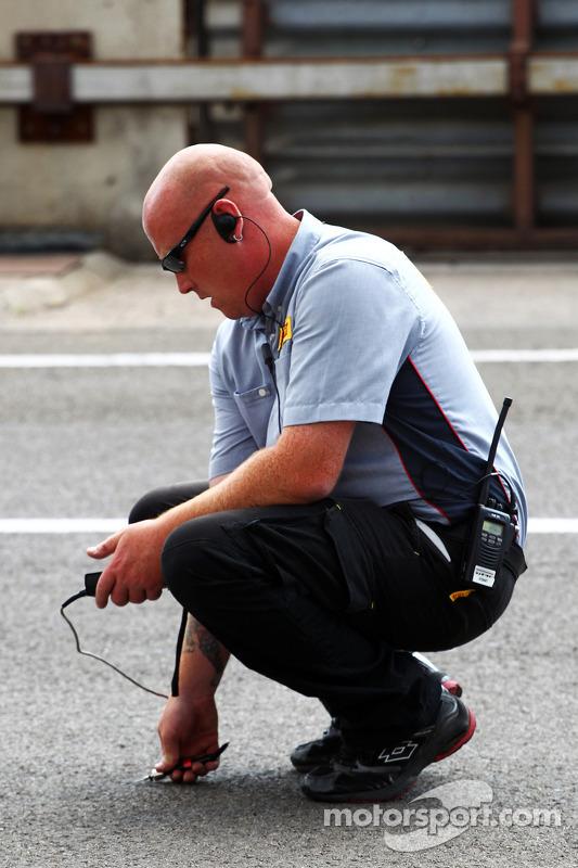 Pirelli Technician takes a track temperature reading