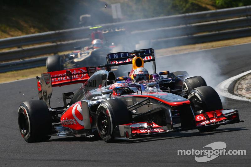 Jenson Button, McLaren MP4-28 and Sebastian Vettel, Red Bull Racing RB9 battle for position