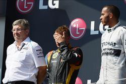 The podium, Ross Brawn, Mercedes AMG F1 Team Principal; Kimi Raikkonen, Lotus F1 Team, second; Lewis