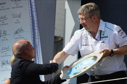 Ross Brawn, Mercedes AMG F1 Team Principal celebrates on the podium