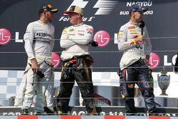 Lewis Hamilton, Mercedes AMG F1; Kimi Räikkönen, Lotus F1 Team; Sebastian Vettel, Red Bull Racing