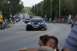 Race cars parade into Elkhart Lake for the Friday concours. #2 2006 Chevrolet Corvette: Dave Roberts