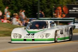 Race cars parade into Elkhart Lake for the Friday concours. #44 1983 XJR-5: Robert Boller
