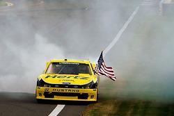 Race winner Brad Keselowski celebrates