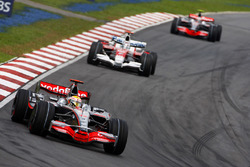 Lewis Hamilton, McLaren MP4-23, leads Jarno Trulli, Toyota TF108 and Heikki Kovalainen, McLaren MP4-23