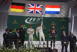 Lewis Hamilton, Mercedes AMG, celebrates victory on the podium alongside Nico Rosberg, Mercedes F1 W07 Hybrid and Max Verstappen, Red Bull Racing RB12