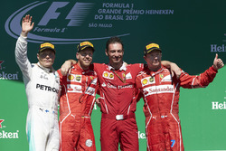 Second place Valtteri Bottas, Mercedes AMG F1, Race winner Sebastian Vettel, Ferrari, Giuseppe Vietina, Race Operations Manager, Ferrari, Third place Kimi Raikkonen, Ferrari, on the podium