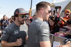Fernando Alonso, McLaren and Stoffel Vandoorne, McLaren sign autographs for the fans