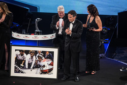 Nelson Piquet receives a lifetime achievement award from Gordon Murray, Herbie Blash and Julia Piquet