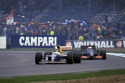 Damon Hill, Williams FW15C, leads Andrea de Cesaris, Tyrrell 020C