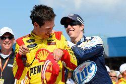 Race winner Joey Logano is congratulated by teammate Brad Keselowski