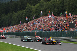 Sebastian Vettel, Red Bull Racing leads at the start of the race