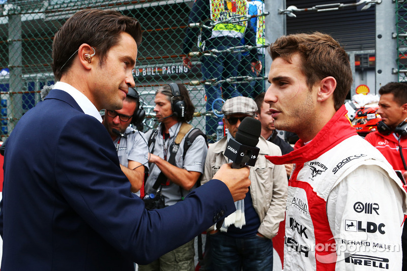 Jules Bianchi, Marussia F1 Team with Thomas Senecal, Canal+ F1 Chief Editor and TV Presenter on the grid