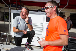 Tom Kristensen talks with a DeltaWing Racing Cars team member