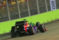 Sebastian Vettel, Red Bull Racing RB9 passes Charles Pic, Caterham CT03 with sparks flying