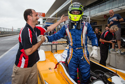 PC pole winner Renger van der Zande celebrates with Elton Julian