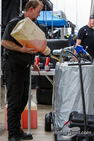Pit crew pouring fuel