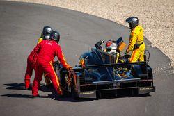 James Rossiter gets back inside his damaged car