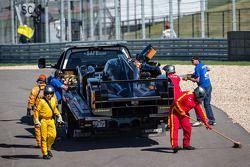 #31 Lotus Lotus T128: Kevin Weeda, Vitantonio Liuzzi, James Rossiter put on the platform truck