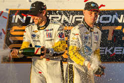 GT podium: champagne for Antonio Garcia and Jan Magnussen
