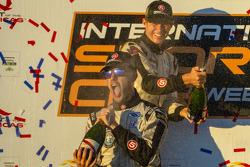P2 podium: champagne for Marino Franchitti and Ryan Briscoe