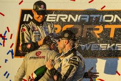 P2 podium: champagne for Marino Franchitti, Scott Tucker and Ryan Briscoe