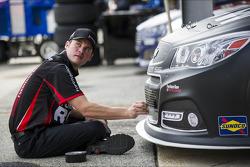 A Furniture Row Racing crew member