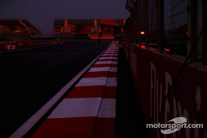 sun sets over circuit