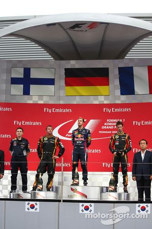 1st place Sebastian Vettel, Red Bull Racing, 2nd place Kimi Raikkonen, Lotus F1 Team and 3rd place R