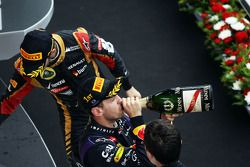Race winner Sebastian Vettel, Red Bull Racing celebrates on the podium with third placed Romain Gros