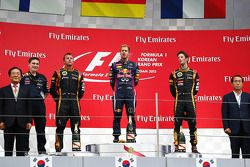 Race winner Sebastian Vettel, second place Kimi Raikkonen, third place Romain Grosjean